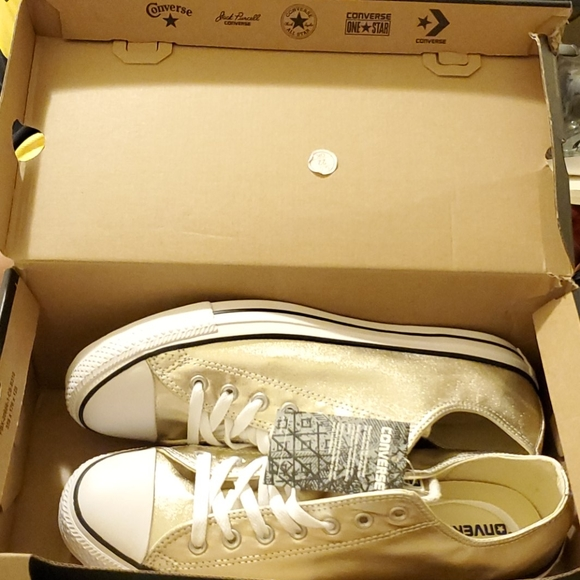 A brand new pair of Gold and White Converse